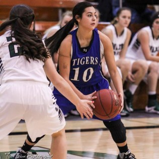St. John Lady Tiger #10 Jackie Rios looks for a teammate to pass the ball to. The Central Plains Lady Oilers defeated the St. John Lady Tigers by a score of 87 to 41 at Central Plains High School in Claflin, Kansas on December 13, 2016. (Photo: Joey Bahr, www.joeybahr.com)