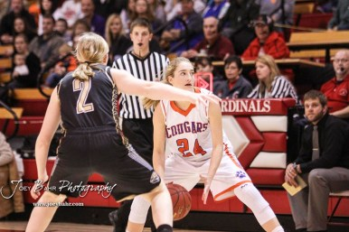 Otis-Bison Lady Cougar #24 Cristen Trapp looks for a teammate to pass the ball to as LaCrosse Lady Leopard #2 Emma Rues defends. The Otis-Bison Lady Cougars defeated the LaCrosse Lady Leopards 61 to 55 in the Girls Semi-Final of the 2017 Hoisington Winter Jam at Hoisington Activity Center in Hoisington, Kansas on January 20, 2017. (Photo: Joey Bahr, www.joeybahr.com)