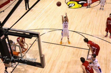 Otis-Bison Cougar #33 Anton Foust shoots a free throw attempt. The Hoisington Cardinals defeated Otis-Bison Cougars 56 to 39 in the Boys Semi-Final of the 2017 Hoisington Winter Jam at Hoisington Activity Center in Hoisington, Kansas on January 20, 2017. (Photo: Joey Bahr, www.joeybahr.com)