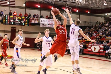 Otis-Bison Cougar #11 Trevor Trapp tries to block a shot from Hoisington Cardinal #22 Grant Dolechek. The Hoisington Cardinals defeated Otis-Bison Cougars 56 to 39 in the Boys Semi-Final of the 2017 Hoisington Winter Jam at Hoisington Activity Center in Hoisington, Kansas on January 20, 2017. (Photo: Joey Bahr, www.joeybahr.com)