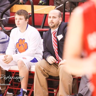 Otis-Bison Cougar Head Coach Curtis Little watches a defensive play develop. The Hoisington Cardinals defeated Otis-Bison Cougars 56 to 39 in the Boys Semi-Final of the 2017 Hoisington Winter Jam at Hoisington Activity Center in Hoisington, Kansas on January 20, 2017. (Photo: Joey Bahr, www.joeybahr.com)