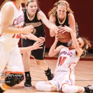 Otis-Bison Lady Cougar #10 Taylor Regan slides trying to grab a loose ball as LaCrosse Lady Leopard #25 Addie Kershner reaches for it too. The Otis-Bison Lady Cougars defeated the LaCrosse Lady Leopards 61 to 55 in the Girls Semi-Final of the 2017 Hoisington Winter Jam at Hoisington Activity Center in Hoisington, Kansas on January 20, 2017. (Photo: Joey Bahr, www.joeybahr.com)