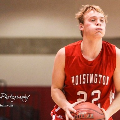 Hoisington Cardinal #22 Grant Dolechek prepares to shoot the ball. The Hoisington Cardinals defeated Otis-Bison Cougars 56 to 39 in the Boys Semi-Final of the 2017 Hoisington Winter Jam at Hoisington Activity Center in Hoisington, Kansas on January 20, 2017. (Photo: Joey Bahr, www.joeybahr.com)