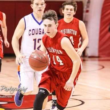 Hoisington Cardinal #14 Alex Schremmer drives down the court. The Hoisington Cardinals defeated Otis-Bison Cougars 56 to 39 in the Boys Semi-Final of the 2017 Hoisington Winter Jam at Hoisington Activity Center in Hoisington, Kansas on January 20, 2017. (Photo: Joey Bahr, www.joeybahr.com)