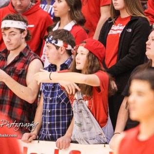 A Hoisington High School student makes the traveling signal after it was called on the opposing team. The Hoisington Cardinals defeated Otis-Bison Cougars 56 to 39 in the Boys Semi-Final of the 2017 Hoisington Winter Jam at Hoisington Activity Center in Hoisington, Kansas on January 20, 2017. (Photo: Joey Bahr, www.joeybahr.com)