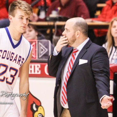 Otis-Bison Cougar Head Coach Curtis Little gives a play to #23 Maitland Wiltse. The Hoisington Cardinals defeated Otis-Bison Cougars 56 to 39 in the Boys Semi-Final of the 2017 Hoisington Winter Jam at Hoisington Activity Center in Hoisington, Kansas on January 20, 2017. (Photo: Joey Bahr, www.joeybahr.com)