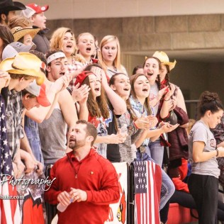 The Hoisington Student Section cheers in victory as the clock winds down at the end of the game. The Hoisington Cardinals defeated Otis-Bison Cougars 56 to 39 in the Boys Semi-Final of the 2017 Hoisington Winter Jam at Hoisington Activity Center in Hoisington, Kansas on January 20, 2017. (Photo: Joey Bahr, www.joeybahr.com)