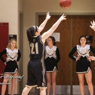 LaCrosse Lady Leopard #21 Taylor Morgan shoots a three point shot. The Otis-Bison Lady Cougars defeated the LaCrosse Lady Leopards 61 to 55 in the Girls Semi-Final of the 2017 Hoisington Winter Jam at Hoisington Activity Center in Hoisington, Kansas on January 20, 2017. (Photo: Joey Bahr, www.joeybahr.com)