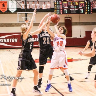 Otis-Bison Lady Cougar #20 Sheridan Ewy pulls in a rebound. The Otis-Bison Lady Cougars defeated the LaCrosse Lady Leopards 61 to 55 in the Girls Semi-Final of the 2017 Hoisington Winter Jam at Hoisington Activity Center in Hoisington, Kansas on January 20, 2017. (Photo: Joey Bahr, www.joeybahr.com)
