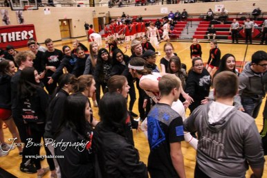 Great Bend Panther #12 Brayden Smith runs through a tunnel of students prior to the game. The Hays Indians defeated the Great Bend Panthers by a score of 51 to 37 at Great Bend High School in Great Bend, Kansas on January 10, 2017. (Photo: Joey Bahr, www.joeybahr.com)