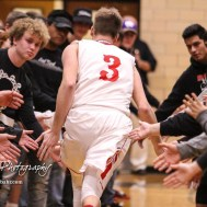 Great Bend Panther #3 Kody Crosby greets student supporters before the game. The Hays Indians defeated the Great Bend Panthers by a score of 51 to 37 at Great Bend High School in Great Bend, Kansas on January 10, 2017. (Photo: Joey Bahr, www.joeybahr.com)
