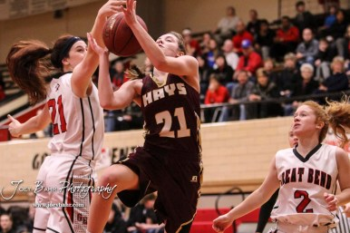 Great Bend Lady Panther #21 Kate Warren reaches for the ball as Hays Lady Indian #21 Savannah Schneider goes for a layup. The Great Bend Lady Panthers defeated the Hays Lady Indians by a score of 54 to 41 at Great Bend High School in Great Bend, Kansas on January 10, 2017. (Photo: Joey Bahr, www.joeybahr.com)