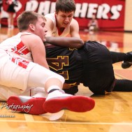 Great Bend Panthers #22 Koy Brack and #3 Kody Crosby grapple with Hays Indian #14 Tyrese Hill for a loose ball. The Hays Indians defeated the Great Bend Panthers by a score of 51 to 37 at Great Bend High School in Great Bend, Kansas on January 10, 2017. (Photo: Joey Bahr, www.joeybahr.com)