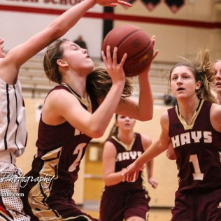 Hays Lady Indian #21 Savannah Schneider takes a shot as Great Bend Lady Panther #25 Carly Dreiling reaches over for the ball. The Great Bend Lady Panthers defeated the Hays Lady Indians by a score of 54 to 41 at Great Bend High School in Great Bend, Kansas on January 10, 2017. (Photo: Joey Bahr, www.joeybahr.com)