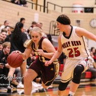 Hays Lady Indian #21 Savannah Schneider tries to fend off Great Bend Lady Panther #25 Carly Dreiling as she drives down the court. The Great Bend Lady Panthers defeated the Hays Lady Indians by a score of 54 to 41 at Great Bend High