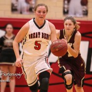 Great Bend Lady Panther #5 Camryn Dunekack drives down the court as Hays Lady Indian #1 Talyn Kleweno pursues. The Great Bend Lady Panthers defeated the Hays Lady Indians by a score of 54 to 41 at Great Bend High School in Great Bend, Kansas on January 10, 2017. (Photo: Joey Bahr, www.joeybahr.com)