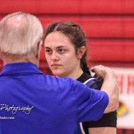 Tia Hayworth (Lincoln) talks with a coach following the match. The Hoisington Cardinal Duals were held at the Hoisington Activity Center in Hoisington, Kansas on January 12, 2017. (Photo: Joey Bahr, www.joeybahr.com)