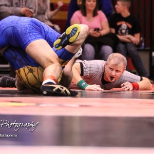 A referee watches the shoulders of Denver Jenkins (Chaparral) as Coy Moran (Leon-Bluestem) tries to pin him in weight class 170. The Hoisington Cardinal Duals were held at the Hoisington Activity Center in Hoisington, Kansas on January 12, 2017. (Photo: Joey Bahr, www.joeybahr.com)
