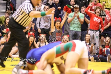 A cheerleader celebrates Colton Hutchinson's (Smith Center) win in the weight class 145 semi-finals. The KSHSAA Class 321A State Wrestling Championships were held at Gross Memorial Coliseum on the campus of Fort Hays State University in Hays, Kansas on February 24, 2017. (Photo: Joey Bahr, www.joeybahr.com)