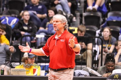 Hoisington Head Coach Dan Schmidt talks to Tanner Cassity during the weight class 132 fifth place match. The KSHSAA Class 321A State Wrestling Championships were held at Gross Memorial Coliseum on the campus of Fort Hays State University in Hays, Kansas on February 25, 2017. (Photo: Joey Bahr, www.joeybahr.com)