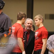 Hoisington Head Coach talks to Jonathan and Christopher Ball prior to the start of the Championship Finals. The KSHSAA Class 321A State Wrestling Championships were held at Gross Memorial Coliseum on the campus of Fort Hays State University in Hays, Kansas on February 25, 2017. (Photo: Joey Bahr, www.joeybahr.com)