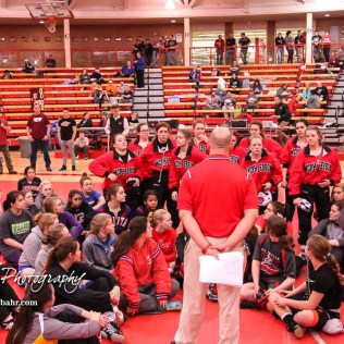 McPherson Wrestling Coach Doug Kretzer asks his team to stand up during a talk to all competitors prior to the start of the meet. The first ever Kansas High School Girls Wrestling Championship was held at the Roundhouse at McPherson High School in McPherson, Kansas on February 11, 2017. (Photo: Joey Bahr, www.joeybahr.com)