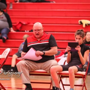 Jefferson West coach Shawn Dolezilek calls out to his wrestler during a match. Fellow wrestler, Jamie Winebrenner, records the match for later review. The first ever Kansas High School Girls Wrestling Championship was held at the Roundhouse at McPherson High School in McPherson, Kansas on February 11, 2017. (Photo: Joey Bahr, www.joeybahr.com)