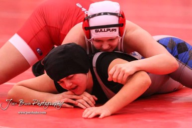 Nicole Winsky (McPherson) tries to cover Tia Hayworth (Lincoln), who won by fall. The first ever Kansas High School Girls Wrestling Championship was held at the Roundhouse at McPherson High School in McPherson, Kansas on February 11, 2017. (Photo: Joey Bahr, www.joeybahr.com)
