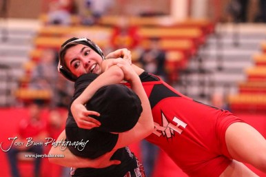 Anayka Besco (Rose Hill) spins over Amanda Newcomb (Osawatomie). Besco won the match in a 11-3 major decision to take the weight class 106 State Championship. The first ever Kansas High School Girls Wrestling Championship was held at the Roundhouse at McPherson High School in McPherson, Kansas on February 11, 2017. (Photo: Joey Bahr, www.joeybahr.com)