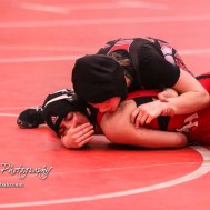 Amanda Newcomb (Osawatomie) tries to score some points on Anayka Besco (Rose Hill). Besco won the match on an 11 to 3 major decision. The first ever Kansas High School Girls Wrestling Championship was held at the Roundhouse at McPherson High School in McPherson, Kansas on February 11, 2017. (Photo: Joey Bahr, www.joeybahr.com)
