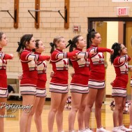 The McPherson Cheerleaders line up for the National Anthem prior to the game. The McPherson Bullpups defeated the Great Bend Panthers with a score of 57 to 30 at the Great Bend High School Fieldhouse in Great Bend, Kansas on February 7, 2017. (Photo: Joey Bahr, www.joeybahr.com)