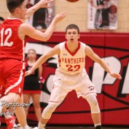 Great Bend Panther #22 Koy Brack watches McPherson Bullpup #12 Mason Alexander pass the ball. The McPherson Bullpups defeated the Great Bend Panthers with a score of 57 to 30 at the Great Bend High School Fieldhouse in Great Bend, Kansas on February 7, 2017. (Photo: Joey Bahr, www.joeybahr.com)