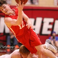 McPherson Bullpup #12 Mason Alexander tosses the ball after Great Bend Panther #11 Konner Ireland collides with him. The McPherson Bullpups defeated the Great Bend Panthers with a score of 57 to 30 at the Great Bend High School Fieldhouse in Great Bend, Kansas on February 7, 2017. (Photo: Joey Bahr, www.joeybahr.com)
