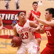 Great Bend Panther #23 Jacob Murray pulls in the ball as he goes for the lane while McPherson Bullpup #21 Thomas Diggs defends. The McPherson Bullpups defeated the Great Bend Panthers with a score of 57 to 30 at the Great Bend High School Fieldhouse in Great Bend, Kansas on February 7, 2017. (Photo: Joey Bahr, www.joeybahr.com)
