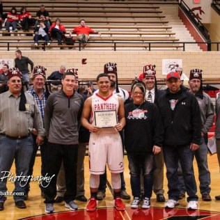 Coaches, family and local Kansas Shriners join Great Bend Panther #23 Jacob Murray in a group photo after a ceremony commemorating his acceptance to the 44th Kansas Shrine Bowl. The McPherson Bullpups defeated the Great Bend Panthers with a score of 57 to 30 at the Great Bend High School Fieldhouse in Great Bend, Kansas on February 7, 2017. (Photo: Joey Bahr, www.joeybahr.com)