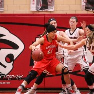 McPherson Lady Bullpup #40 Mandi Cooks makes a move to the basket as the Great Bend Lady Panther defense collapses down. The McPherson Lady Bullpups defeated the Great Bend Lady Panthers with a score of 69 to 38 at the Great Bend High School Fieldhouse in Great Bend, Kansas on February 7, 2017. (Photo: Joey Bahr, www.joeybahr.com)
