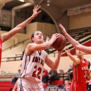 McPherson Lady Bullpup #24 Riley Hett gets a hand up as Great Bend Lady Panther #22 Carley Brack goes for a shot. The McPherson Lady Bullpups defeated the Great Bend Lady Panthers with a score of 69 to 38 at the Great Bend High School Fieldhouse in Great Bend, Kansas on February 7, 2017. (Photo: Joey Bahr, www.joeybahr.com)