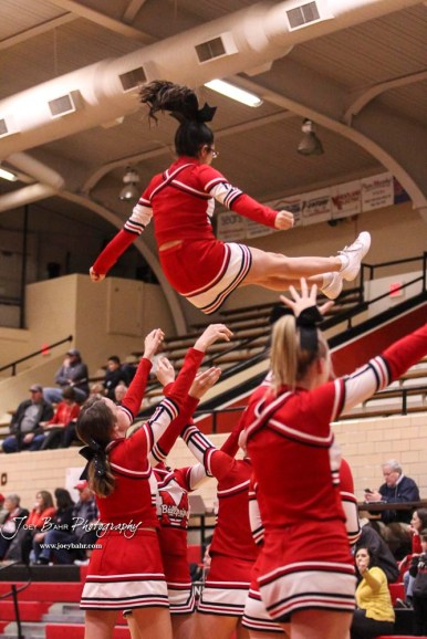 The McPherson cheerleaders perform a stunt during a time out. The McPherson Lady Bullpups defeated the Great Bend Lady Panthers with a score of 69 to 38 at the Great Bend High School Fieldhouse in Great Bend, Kansas on February 7, 2017. (Photo: Joey Bahr, www.joeybahr.com)