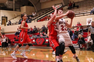 Great Bend Lady Panther #22 Carley Brack goes for a layup as McPherson Lady Bullpup #20 Ashlie Stout defends. The McPherson Lady Bullpups defeated the Great Bend Lady Panthers with a score of 69 to 38 at the Great Bend High School Fieldhouse in Great Bend, Kansas on February 7, 2017. (Photo: Joey Bahr, www.joeybahr.com)