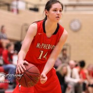 McPherson Lady Bullpup #14 Lakyn Schieferecke looks for a teammate to pass the ball to. The McPherson Lady Bullpups defeated the Great Bend Lady Panthers with a score of 69 to 38 at the Great Bend High School Fieldhouse in Great Bend, Kansas on February 7, 2017. (Photo: Joey Bahr, www.joeybahr.com)