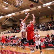 McPherson Lady Bullpup #30 Taylor Robertson goes for a layup as Great Bend Lady Panther #22 Carley Brack defends. The McPherson Lady Bullpups defeated the Great Bend Lady Panthers with a score of 69 to 38 at the Great Bend High School Fieldhouse in Great Bend, Kansas on February 7, 2017. (Photo: Joey Bahr, www.joeybahr.com)
