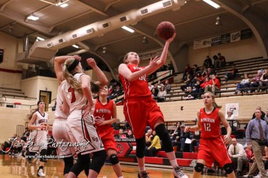 McPherson Lady Bullpup #30 Taylor Robertson likes past the defense for a layup. The McPherson Lady Bullpups defeated the Great Bend Lady Panthers with a score of 69 to 38 at the Great Bend High School Fieldhouse in Great Bend, Kansas on February 7, 2017. (Photo: Joey Bahr, www.joeybahr.com)