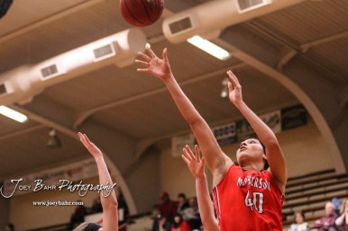 McPherson Lady Bullpup #40 Mandi Cooks shoots over the Great Bend Lady Panther defense. The McPherson Lady Bullpups defeated the Great Bend Lady Panthers with a score of 69 to 38 at the Great Bend High School Fieldhouse in Great Bend, Kansas on February 7, 2017. (Photo: Joey Bahr, www.joeybahr.com)