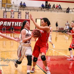 McPherson Lady Bullpup #4 Claire Yowell defends as Great Bend Lady Panther #25 Carly Dreiling goes for a layup. The McPherson Lady Bullpups defeated the Great Bend Lady Panthers with a score of 69 to 38 at the Great Bend High School Fieldhouse in Great Bend, Kansas on February 7, 2017. (Photo: Joey Bahr, www.joeybahr.com)