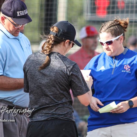 Great Bend Lady Panther Head Coach Carrie Minton and Dodge City Lady Demon Head Coach Ashley Podschun exchange lineups with Home Plate Umpire Mark Brock. The Great Bend Lady Panthers defeated the Dodge City Lady Demons 15 to 5 at the Great Bend Sports Complex in Great Bend, Kansas on April 18, 2017. (Photo: Joey Bahr, www.joeybahr.com)