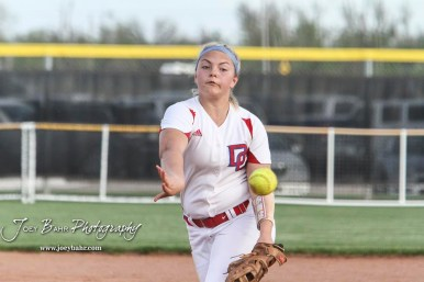 Dodge City Lady Demon #4 Reagan Lopp throws a pitch in the Bottom of the 2nd Inning. The Great Bend Lady Panthers defeated the Dodge City Lady Demons 15 to 5 at the Great Bend Sports Complex in Great Bend, Kansas on April 18, 2017. (Photo: Joey Bahr, www.joeybahr.com)