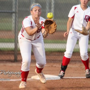 Dodge City Lady Demon #4 Reagan Lopp catches a ball to try and cover Third Base in the Bottom of the 3rd Inning. The Great Bend Lady Panthers defeated the Dodge City Lady Demons 15 to 5 at the Great Bend Sports Complex in Great Bend, Kansas on April 18, 2017. (Photo: Joey Bahr, www.joeybahr.com)