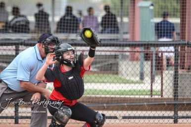 Great Bend Lady Panther #14 Kaylee Unruh catches a pitch in the Top of the 4th Inning. The Great Bend Lady Panthers defeated the Dodge City Lady Demons 15 to 5 at the Great Bend Sports Complex in Great Bend, Kansas on April 18, 2017. (Photo: Joey Bahr, www.joeybahr.com)