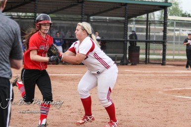 Dodge City Lady Demon #32 Emily Stephenson tags Great Bend Lady Panther #20 Brooklyn Burkhart in an unassisted play in the Bottom of the 4th Inning. The Great Bend Lady Panthers defeated the Dodge City Lady Demons 15 to 5 at the Great Bend Sports Complex in Great Bend, Kansas on April 18, 2017. (Photo: Joey Bahr, www.joeybahr.com)
