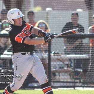 Ellis Railroader #21 Bryce Keithley swings at a pitch in the bottom of the first inning. The Bluestem Lions defeated the Ellis Railroaders 8 to 5 in the KSHSAA Class 2-1A State Baseball Championship game at Great Bend Sports Complex in Great Bend, Kansas on May 26, 2017. (Photo: Joey Bahr, www.joeybahr.com)